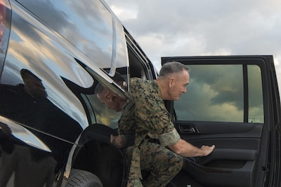 Marine Corps Gen. Joe Dunford exits an SUV.