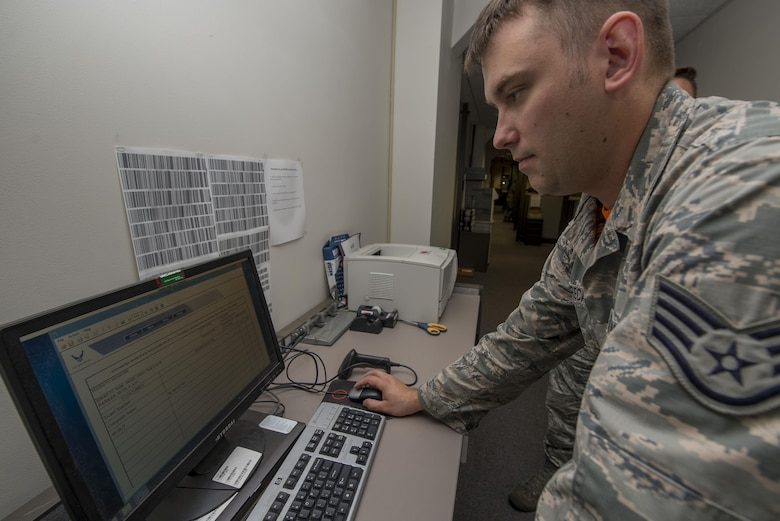 Staff Sgt. Jason Greca, 375th Communications Squadron Client Support Technician, creates a hand receipt for computer equipment being dropped off for repair.