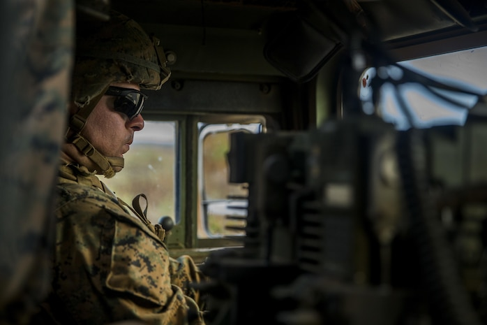 U.S. Marine Lance Cpl. John Pesto, driver of a High Mobility Multipurpose Wheeled Vehicle at the mobile assault course during Exercise Bougainville II at the Pohakuloa Training Area, on the island of Hawaii, Oct. 23, 2017. Exercise Bougainville II prepares 2nd Battalion, 3rd Marines for service as a forward deployed force in the Pacific by training them to fight as a ground combat element in a Marine Air-Ground Task Force. Lance Cpl. Pesto is with Combined Anti-Armor Team 1, 2nd Bn., 3rd Marines, and native of Batavia, N.Y.