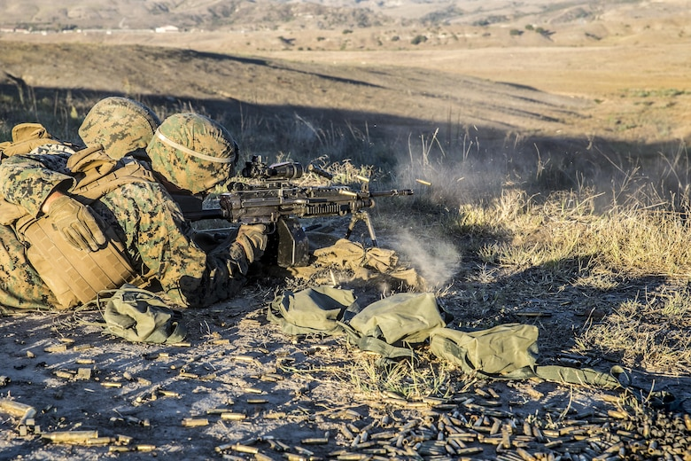 U.S. Marines with 1st Law Enforcement Battalion, I Marine Information Group, engage targets with the M249 squad automatic weapon during a live fire training exercise on Camp Pendleton, Calif., Oct. 24, 2017. The importance of this exercise was to prepare the Marines for their upcoming deployment with the 13th Marine Expeditionary Unit.