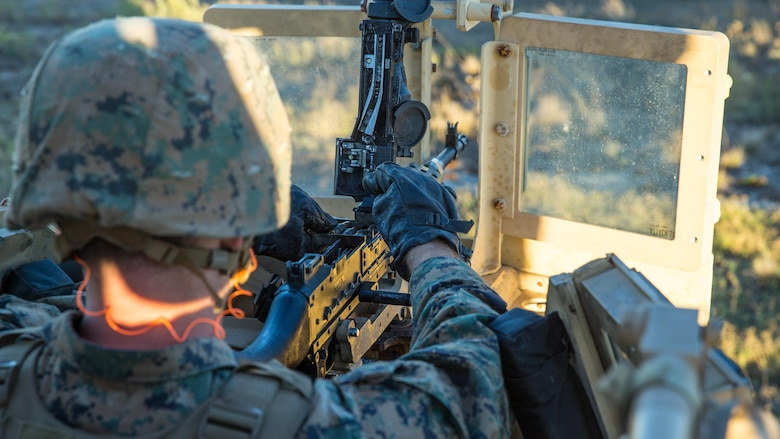 A Marine with 1st Law Enforcement Battalion, I Marine Information Group, loads the M240B machine gun during a live fire training exercise on Camp Pendleton, Calif., Oct. 24, 2017.The importance of this exercise was to prepare the Marines for their upcoming deployment with the 13th Marine Expeditionary Unit.