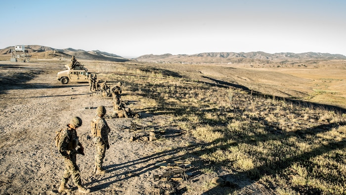 U.S. Marines with 1st Law Enforcement Battalion, I Marine Information Group, engage targets with the M249 squad automatic weapons during a live fire training exercise at range 407C on Camp Pendleton, Calif., Oct. 24, 2017. The importance of this exercise was to prepare the Marines for their upcoming deployment with the 13th Marine Expeditionary Unit.