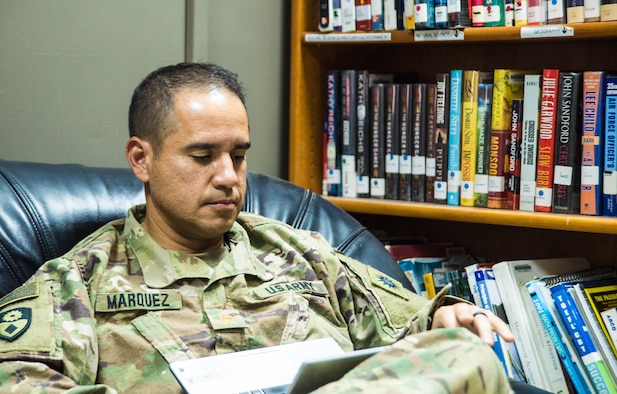 U.S. Army Maj. William Marquez, California National Guard, 40th Infantry Division, Information Operations Officer uses the 386th Expeditionary Force Support Squadron Learning Resource Center's wifi at an undisclosed location in Southwest Asia, Oct 22, 2017. The LRC provides a wide range of educational and entertainment resource in an environment designed to encourage relaxation. (Air Force photo by Staff Sgt. William Banton)