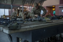 Royal Marines prepare their gear for a ground insertion operation during Bold Alligator 17 at Marine Corps Base Camp Lejeune, Oct. 20, 2017. Bold Alligator 17 is a training exercise focused on a regimental amphibious assault that allows the Navy and Marine Corps team to train with partner nations to refine and strengthen core amphibious competencies critical to maritime power projection.