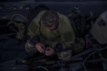 A Royal Marine checks his GPS before participating in a ground insertion operation during Bold Alligator 17 at Marine Corps Base Camp Lejeune, Oct. 20, 2017. Bold Alligator 17 is a training exercise focused on a regimental amphibious assault that allows the Navy and Marine Corps team to train with partner nations to refine and strengthen core amphibious competencies critical to maritime power projection.