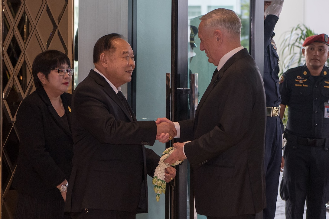 Defense Secretary Jim Mattis shakes hands with Thailand's defense minister.