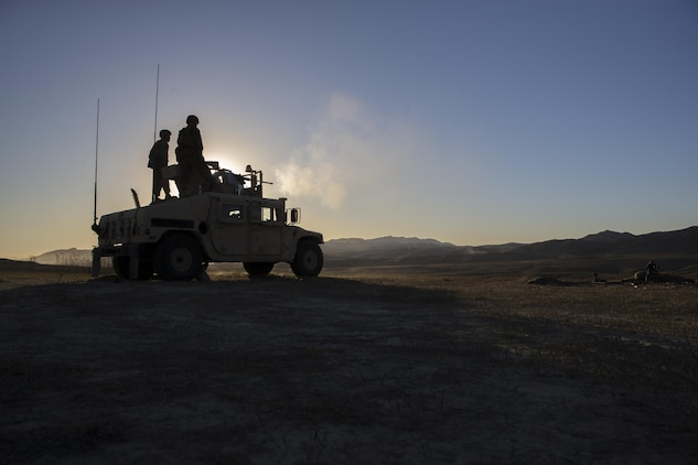 U.S. Marines with 1st Law Enforcement Battalion, I Marine Information Group, inspect an M2 Browning .50 caliber machine gun during a training exercise on Camp Pendleton, Calif., Oct. 24, 2017.The importance of this exercise was to prepare the Marines for their upcoming deployment with the 13th Marine Expeditionary Unit.