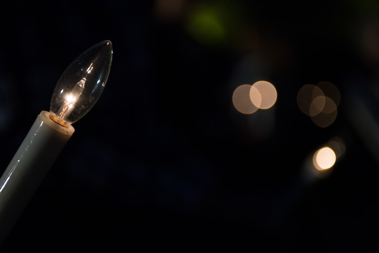Women from the Oklahoma Air and Army National Guard hold candlelights during a remembrance ceremony for all the women servicemembers who have died in the line of duty, Oct. 21, 2017, at the Women in Military Service for America Memorial at Arlington Cemetary in Washington D.C. Nearly 40 Oklahoma Air and Army National Guard women gathered with hundreds of active-duty, retired and reserve servicewomen from all branches of the military to celebrate the 20th anniversary of the dedication of the Women in Military Service for America Memorial to honor the women who came before them and celebrate the opportunities that are still to come. (U.S. Air National Guard photo by Staff Sgt. Kasey Phipps)