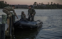 Royal Marines dock a Zodiac Combat Rubber Raiding Craft during Bold Alligator 17 at Marine Corps Base Camp Lejeune, Oct. 20, 2017. Bold Alligator 17 is a training exercise focused on a regimental amphibious assault that allows the Navy and Marine Corps team to train with partner nations to refine and strengthen core amphibious competencies critical to maritime power projection.
