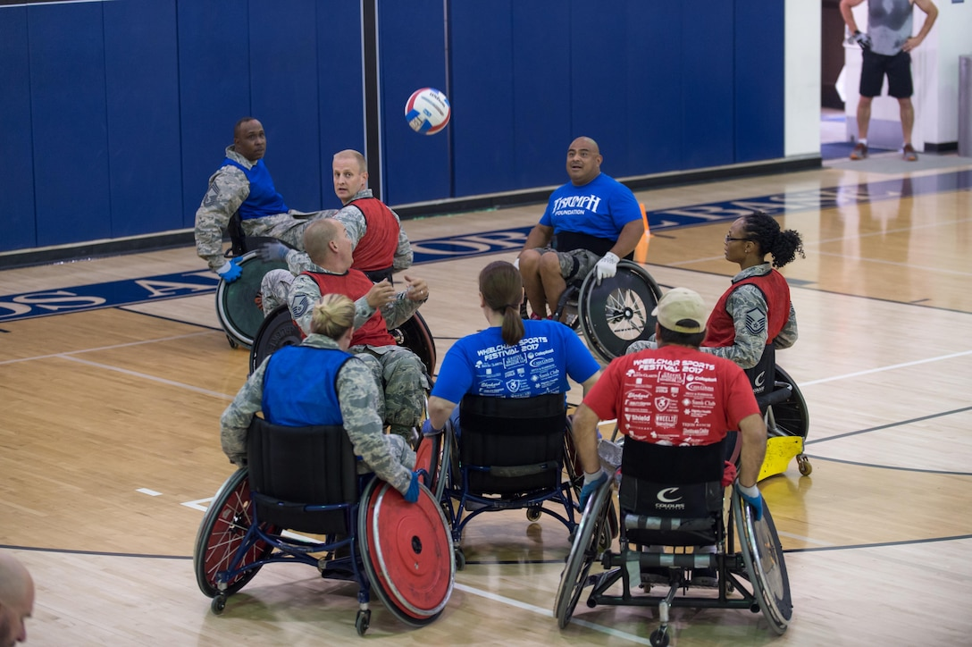 Edwards AFB Airmen participate in a wheelchair rugby game with Triumph Foundation members at the base gym Oct. 24. The event was put on in recognition of National Disability Employment Awareness Month. (U.S. Air Force photo by Kyle Larson)
