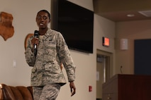 Staff Sgt. Janai, 42nd Attack Squadron commander's support staff NCO in charge, explains how she reacted to and coped with the loss of her brother during a Storytellers event in the Creech auditorium, October 18, 2017. Janai later explained she didn't share her story with her mother prior to this event. (U.S. Air Force photo/Airman 1st Class Haley Stevens)
