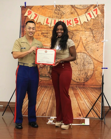 Major Richard Lee, commanding officer of Recruiting Station Tampa, 6th Marine Corps District, presents Staff Sgt. Karen Helms, administration chief with RS Tampa, her certificate of completion for the Lifestyles, Insights, Networking, Knowledge and Skills program's course aboard MacDill Air Force Base, Tampa, Florida, Oct. 19, 2017. The L.I.N.K.S. program is in its 20th year and serves as a tool that spouses and families in the Marine Corps can use to learn about the military lifestyle.  (Official Marine Corps photo by Sgt. Calvin Shamoon)