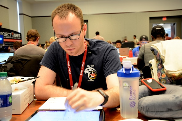 Staff Sgt. Christopher Pineda, 81st Training Support Squadron interactive media developer, programs a safety hack Sept. 23, 2017, during HackState at Mississippi State University in Starkville, Mississippi. The Keesler team participated in a hackathon and won the best safety hack, which was created in 24 hours, for Industrial Paper. (Courtesy photo)