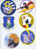 These insignia, going clockwise from the top left, represent the important organizations described in our history: Fifth Air Force, 340th Fighter Squadron, 341st Fighter Squadron, 342nd Fighter Squadron, 460th Fighter Squadron and 348th Fighter Group, 108th Wing. (author's collection)