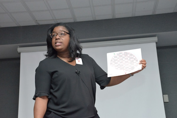 Wanda Gilbert, Employee Assistance Program coordinator with Redstone Arsenal, talks about the results of a navigation exercise during her alcohol and substance abuse class Oct. 24, 2017, at the U.S. Army Engineering and Support Center, Huntsville. Three employees participated in the exercise twice -- once before and once after donning goggles that simulate intoxication. Gilbert's training also included a class on suicide awareness and prevention.