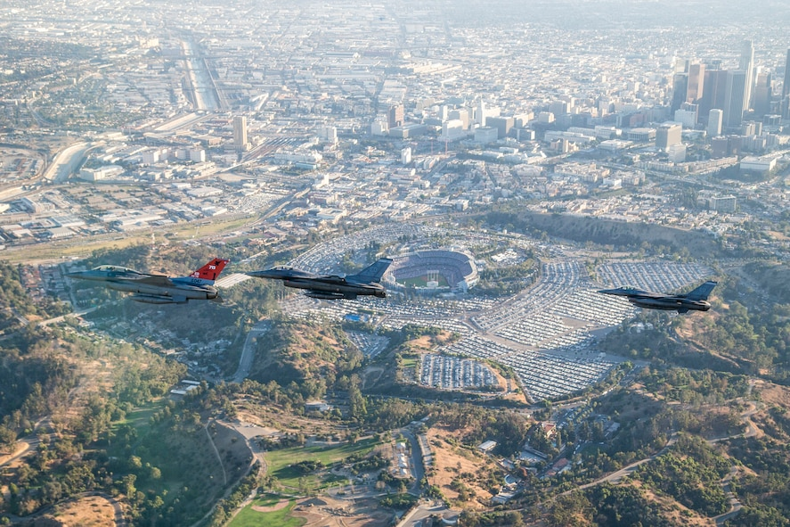 Three F-16 Fighting Falcons from Edwards AFB fly past Dodger Stadium after the ceremonial flyover at the beginning of game two of the 2017 World Series between the Los Angeles Dodgers and Houston Astros Oct. 25. (U.S. Air Force photo by Christopher Okula)