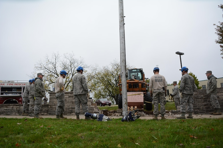 A monument dedicated to the farm youth of Wisconsin who have served their country in the defense of freedom, found a new resting place with help from the Airmen of the 115th Fighter Wing Civil Engineering Squadron and Urban Search and Rescue team based out of Truax Field, Madison, Wisconsin. The 18 Airmen invested approximately 60-75 hours into the movement Oct. 14, with many more hours invested behind the scenes with planning and coordination between the 115th FW's CES, Fire and Emergency Services Flight, and USAR team along with the Wisconsin Department of Agriculture, Trade and Consumer Protection, and Wisconsin Department of Administration – Bureau of Real Estate Management.