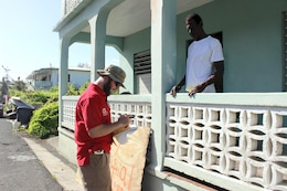 Pasadena, Md., resident Matt Breitenother, of the U.S. Army Corps of Engineers, Baltimore District, assists a homeowner in Frederiksted with assessing his eligibility for the U.S. Army Corps of Engineers Operation Blue Roof Program, Oct. 22, 2017 in St. Croix, U.S. Virgin Islands. Breitenother is one of dozens of Baltimore District employees deploying to assist with hurricane recovery efforts primarily in the U.S. Virgin Islands and Puerto Rico.