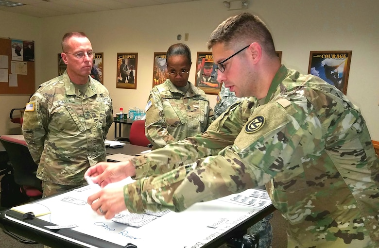 (Far right) Sgt. 1st Class Colby Peterson, an instructor assigned to the 102nd Training Division, teaches a class on building ribbon bridge rafts at the 80th Training Command 2017 Instructor of the Year competition held at Fort Knox, Kentucky, Oct. 20, 2017.