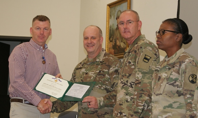 (Left to right) Mr. Troy Winters, Col. Jay Gilhooly, Command Sgt. Maj. Jeffrey Darlington, and Command Sgt. Maj. Sharon Campbell pose for photographs as Winters receives the 80th Training Command 2017 Instructor of the Year civilian award at the completion of the two-day competition at Fort Knox, Kentucky, Oct. 22, 2017.  Winters serves as an instructor for the 83rd Army Reserve Readiness Training Center, 100th Training Division.
