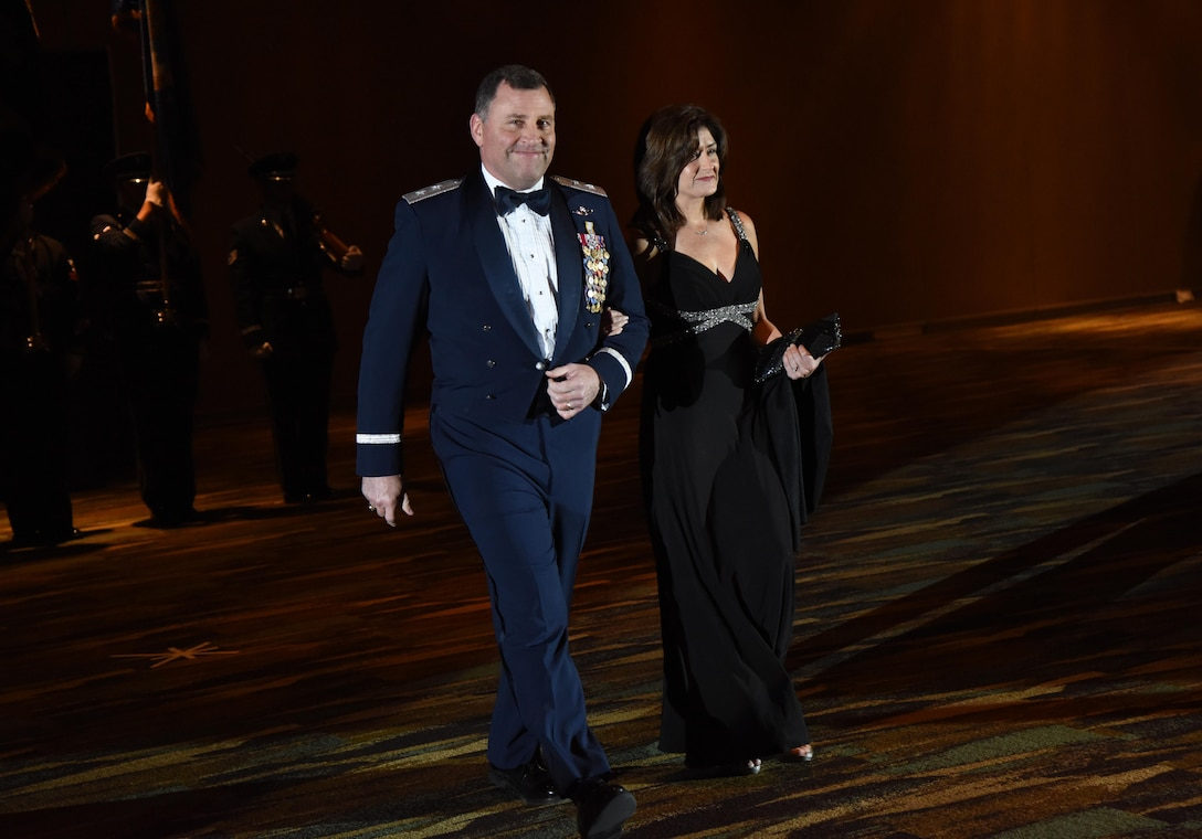 U.S. Air Force Maj. Gen. Timothy Leahy, 2nd Air Force commander, and his wife, Kathy,  make their way to the head table during the 39th Annual Salute to the Military at the Mississippi Coast Convention Center, Oct. 24, 2017, Biloxi, Mississippi. The Salute to the Military event recognized the men and women who serve in the military along the Gulf Coast. (U.S. Air Force photo by Kemberly Groue)
