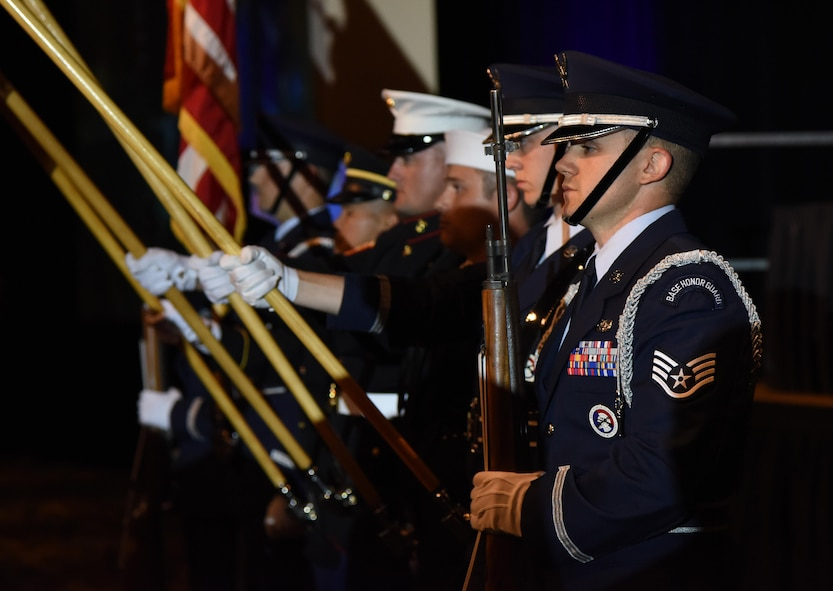 U.S. Air Force Staff Sgt. Luke Phillips, Keesler Honor Guard, participates in presenting the colors during the 39th Annual Salute to the Military at the Mississippi Coast Convention Center, Oct. 24, 2017, Biloxi, Mississippi. The Salute to the Military event recognized the men and women who serve in the military along the Gulf Coast. (U.S. Air Force photo by Kemberly Groue)