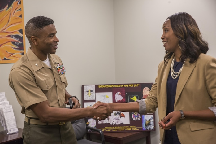 Col. Ricardo Player, the chief of staff of Force Headquarters Group, Marine Forces Reserve, introduces himself to Toni Pickett, the principle of McDonogh 35 High School in New Orleans, between lectures at McDonogh 35 High School, during Red Ribbon Week Oct. 23, 2017.