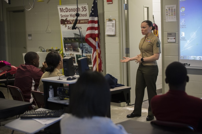 Gunnery Sgt. Kila Legler, the staff secretary for 4th Marine Division, Marine Forces Reserve, discusses how potential drug use can damage a Junior ROTC candidate's future, during Red Ribbon Week, at McDonogh 35 High School in New Orleans, Oct. 23, 2017.