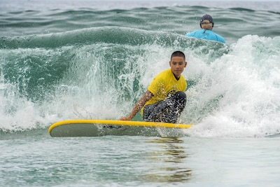 Marine Corps Cpl. Leighton Anderson surfs a closed out wave during the Naval Medical Center San Diego surf therapy clinic in Del Mar, Calif. Sept. 14, 2017. Participation in the therapy clinic for patients like Leighton is medically appointed, and its many benefits include pain management and post-traumatic stress disorder treatment. DoD photo by EJ Hersom