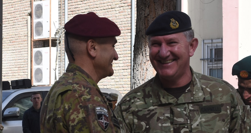 Lieutenant General Richard Cripwell, the new deputy commander of Resolute Support, shakes hands with Lieutenant General Rosario Castellano, the outgoing deputy, during a change of responsibility ceremony at Resolute Support headquarters in Kabul, Afghanistan Oct. 24, 2017. (Photo by Air Force Staff Sergeant Regina Edwards)