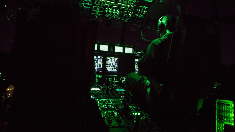 U.S. Marine Corps pilots with Marine Aerial Refueler Transport Squadron (VMGR) 152 based out of Marine Corps Air Station (MCAS) Iwakuni, Japan, pilot a KC-130J Hercules during a nighttime aerial refueling training operation Oct. 25, 2017. The training consisted of refueling the air station's F-35B Lightning II aircraft with Marine Fighter Attack Squadron (VMFA) 121 and F/A-18C Hornets with VMFA-251 based out of MCAS Iwakuni. This training was conducted at night to improve operational readiness and enhance pilot proficiency.