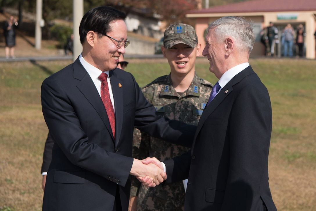 Defense Secretary Jim Mattis shakes hands with the South Korean defense minister.