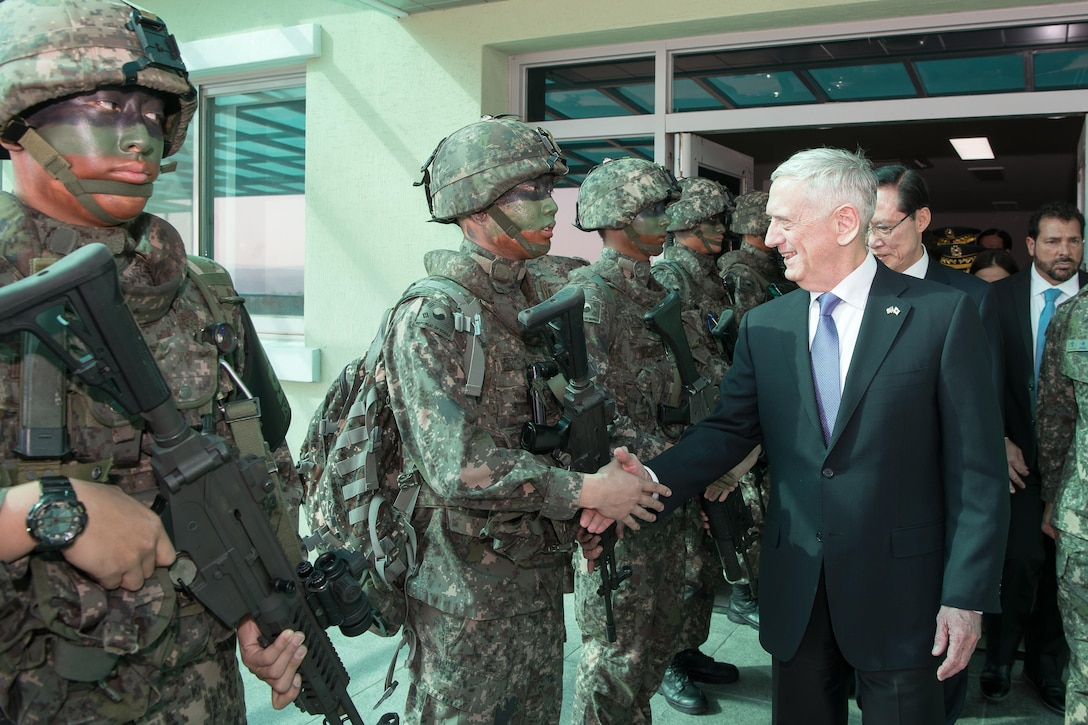 U.S. and South Korean defense leaders greet troops at the Demilitarized Zone.