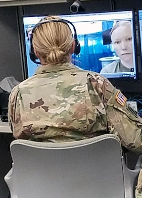Lt. Col. Jennifer Stowe, an optometrist located at the Brooke Army Medical Center Virtual Medical Center, talks with Sgt. Andrea Bloom Oct. 20 during a synchronous virtual health encounter. The mobile medics connected with Stowe and provided high-definition, synchronous images of a Soldier's eye using an optical exam camera and web-based video teleconferencing capability.
