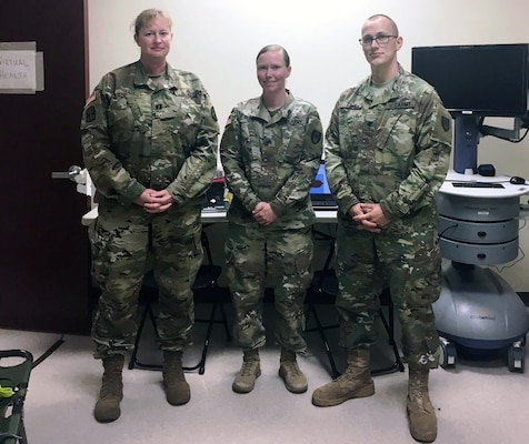 (From left) Capt. Becky Lux, Sgt. Andrea Bloom and Spc. Christian Bark pose for a photo Oct. 26 in Humacao, Puerto Rico. Bloom and Bark are mobile medics from Brooke Army Medical Center who were embedded with the 14th Combat Support Hospital to provide virtual health support to the disaster response effort there.