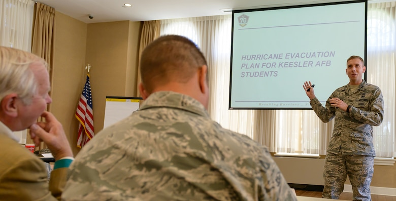 Capt. Keith Van Dyck, 81st Logistical Readiness Squadron director of operations, discusses Keesler's student hurricane evacuation plan with Keesler and community leaders during the Air Force Community Partnership Program Agreements Workshop at the Gulf Park Campus of The University of Southern Mississippi Oct. 25, 2017, Long Beach, Mississippi. The program is part of a larger Air Force Public-Public, Public-Private (P4) initiative to encourage installations and local communities to combine or improve resources or operating processes. Mississippi representatives from state and local communities and various civic leaders attended the event. (U.S. Air Force photo by Andre' Askew)