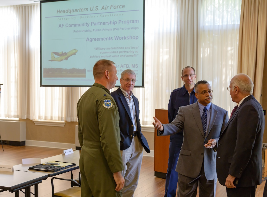 Dr. Wayne Clark, 81st Mission Support Group deputy director, introduces attendees to U.S. Army retired Col. Fred Meurer (right) during the Air Force Community Partnership Program Agreements Workshop at the Gulf Park Campus of The University of Southern Mississippi Oct. 25, 2017, Long Beach, Mississippi. The program is part of a larger Air Force Public-Public, Public-Private (P4) initiative to encourage installations and local communities to combine or improve resources or operating processes. Mississippi representatives from state and local communities and various civic leaders attended the event. (U.S. Air Force photo by Andre' Askew)