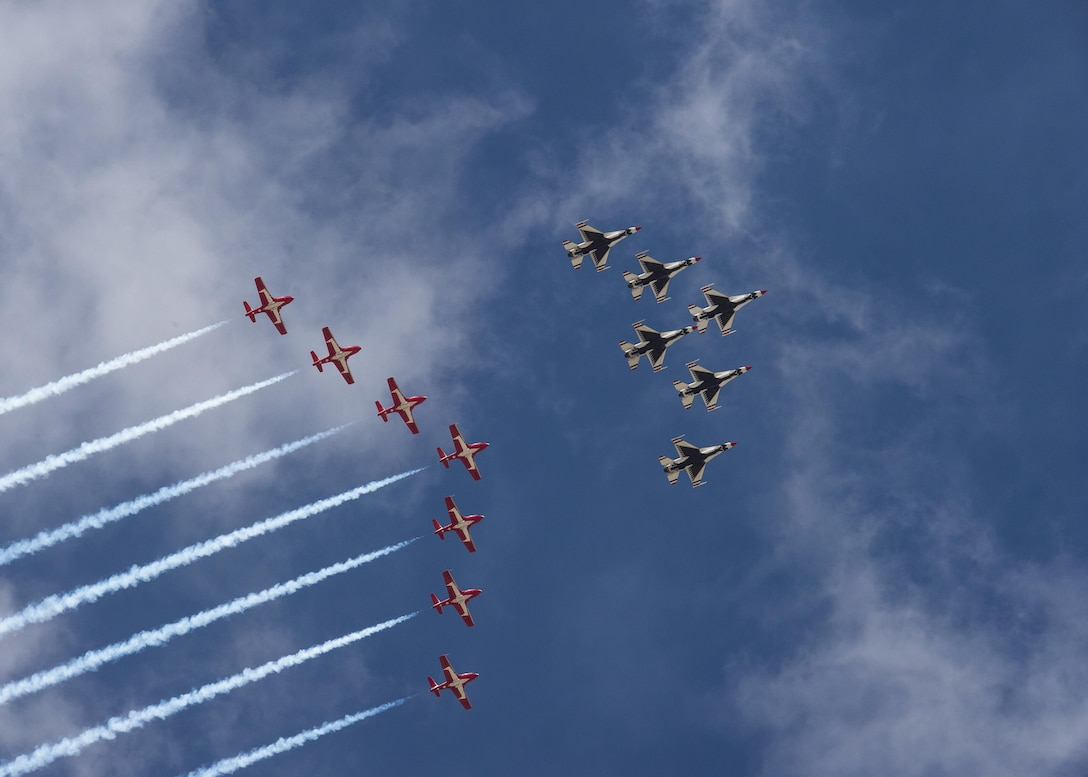 The U.S. Air Force Thunderbirds and the Royal Canadian Snowbirds fly in formation during their arrival to Boise, Idaho Oct. 12, 2017. The Thunderbirds and Snowbirds were both headline acts for the Gowen Thunder Open House and Airshow, the first airshow hosted by the Idaho National Guard in more than 20 years. (U.S. Air National Guard photo by Master Sgt. Joshua C. Allmaras)