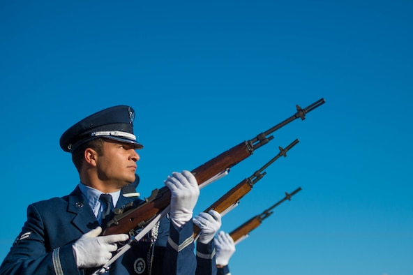 Airman 1st Class Dallas Teran, 56th Force Support Squadron base honor guardsman, prepares to fire his rifle while practicing military funeral honors at Luke Air Force Base, Ariz., Oct 13, 2017. The event was held as a final presentation during a base honor guard graduation. (U.S. Air Force photo/SSgt Jensen Stidham)