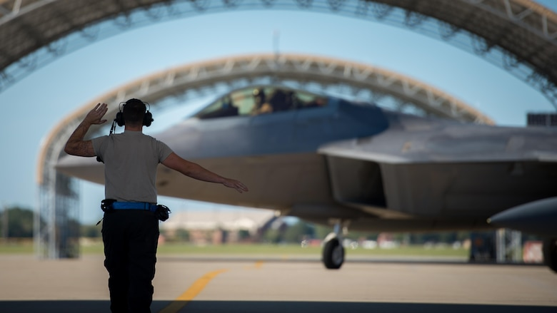 A crew chief signals Lt. Col. Christian Bergtholdt, 27th Fighter Squadron director of operations, as he taxis on the flightline at Joint Base Langley-Eustis, Va., Oct. 19, 2017. During the six-month deployment, F-22 Raptors and Airmen from the 1st Fighter Wing supported the fight against the Islamic State in Iraq and Syria. (U.S. Air Force photo by Staff Sgt. Areca T. Bell)