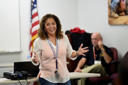 Carmella Navarro, Suicide Prevention Program Manager, 85th Support Command, shares concluding remarks during a five-day Applied Suicide Intervention Skills Training (Training for Trainers) workshop, October 20, 2017.