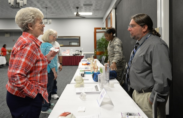 Edie Hyatt speaks with David Ross, 14th Medical Operations Squadron optometry technician, about the benefits retirees are able to utilize Oct. 20, 2017, on Columbus Air Force Base, Mississippi. There are many benefits retirees and beneficiaries may use on military installations, including access to the 14th MDG. (U.S. Air Force photo by Keith Holcomb)