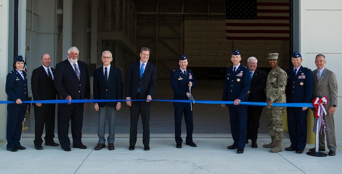 Col. Sean P. Larkin, National Air and Space Intelligence Center commander, and key leaders cuts a ribbon to celebrate the completion of the new foreign materiel exploitation facility here, Oct. 20, 2017.