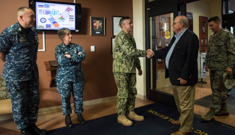 Goose Creek Mayor Michael Heitzler shakes hands with Capt. Dale Barrette, Naval Health Clinic Charleston commanding officer, during an orientation tour of the clinic here, Oct. 25, 2017.
