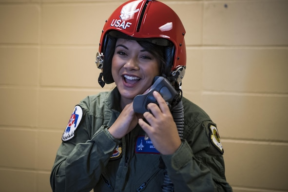 Noelani Mathews, multimedia journalist, laughs while trying on her helmet before her media flight with the U.S. Air Force Thunderbirds, Oct. 27, 2017, at Moody Air Force Base, Ga. The Thunderbirds, based out of Nellis Air Force Base, Nev., are the Air Force's premier aerial demonstration team, performing at air shows and special events worldwide. (U.S. Air Force photo by Senior Airman Janiqua P. Robinson)