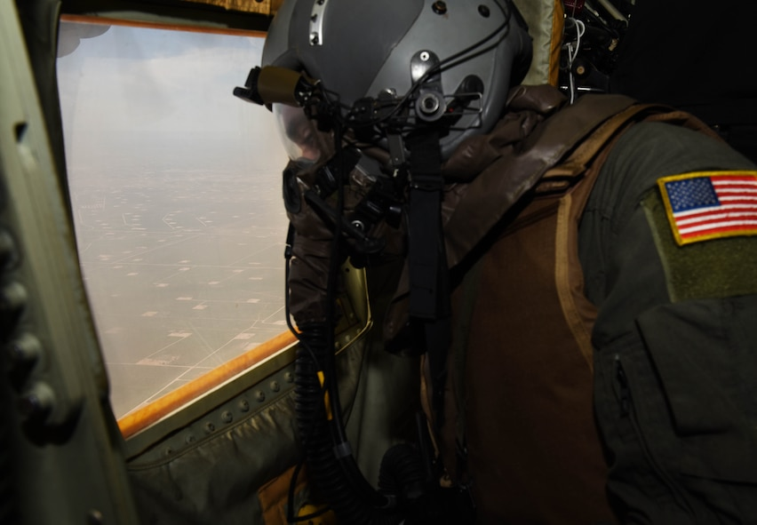Senior Airman James Camera, 40th Airlift Squadron, loadmaster, scans for threats during a full spectrum readiness sortie