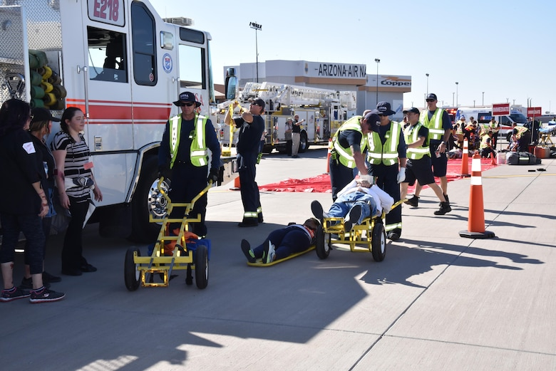 First responders coordinate to assist passengers of an aircraft accident during the 2017 Triennial Exercise here, Oct. 26, 2017. The exercise is a three-year requirement of the Federal Aviation Administration. (U.S. Air Force photo by 2nd Lt. Tinashe Machona)