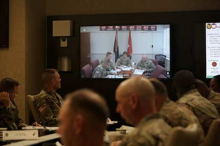 Army Reserve Brig. Gen. Kris Belanger, Commanding General, 85th Support Command, center, gives opening remarks via a video teleconference to First Army brigade command teams during the 85th Support Command's New Brigade Command Teams Orientation brief at Rock Island Arsenal, Illinois, October 22, 2017.