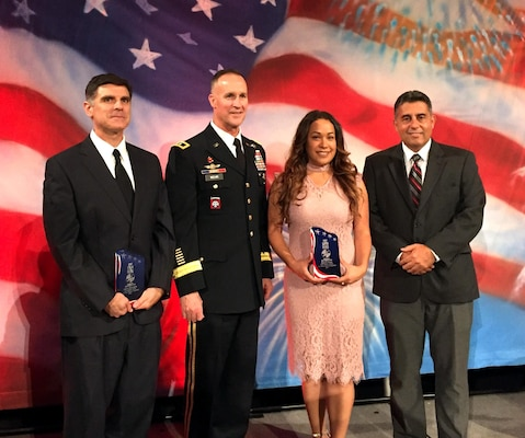Maj. Gen. Michael Wehr, deputy commanding general for the U.S. Army Corps of Engineers, presents Great Minds in STEM awards to (from left) Juan Dominguez, Mayra Flores and Carlos Gonzalez at the 29th annual Hispanic Engineer National Achievement Awards Corporation conference Oct. 18 to 22 in Pasadena, California.