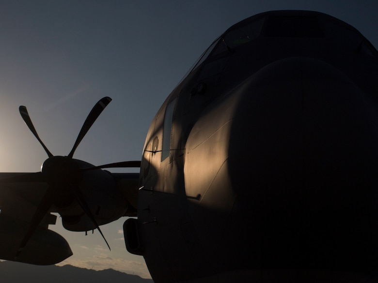 A U.S. Marine Corps KC-130J Hercules with Marine Aerial Refueler Transport Squadron (VMGR) 152 stands by while being prepped for take off before a nighttime aerial refueling training exercise with F-35B Lightning II aircraft with Marine Fighter Attack Squadron (VMFA) 121 and F/A-18C Hornets with VMFA-251 at Marine Corps Air Station Iwakuni, Japan, Oct. 25, 2017. The training was conducted at night to improve operational readiness and enhance pilot proficiency.